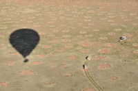 Shadow cast by balloon on fairy circles.  Note the tracking vehicles.
