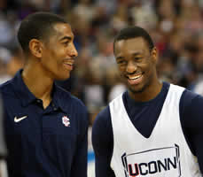 Kevin Ollie-L and Kemba Walker-R